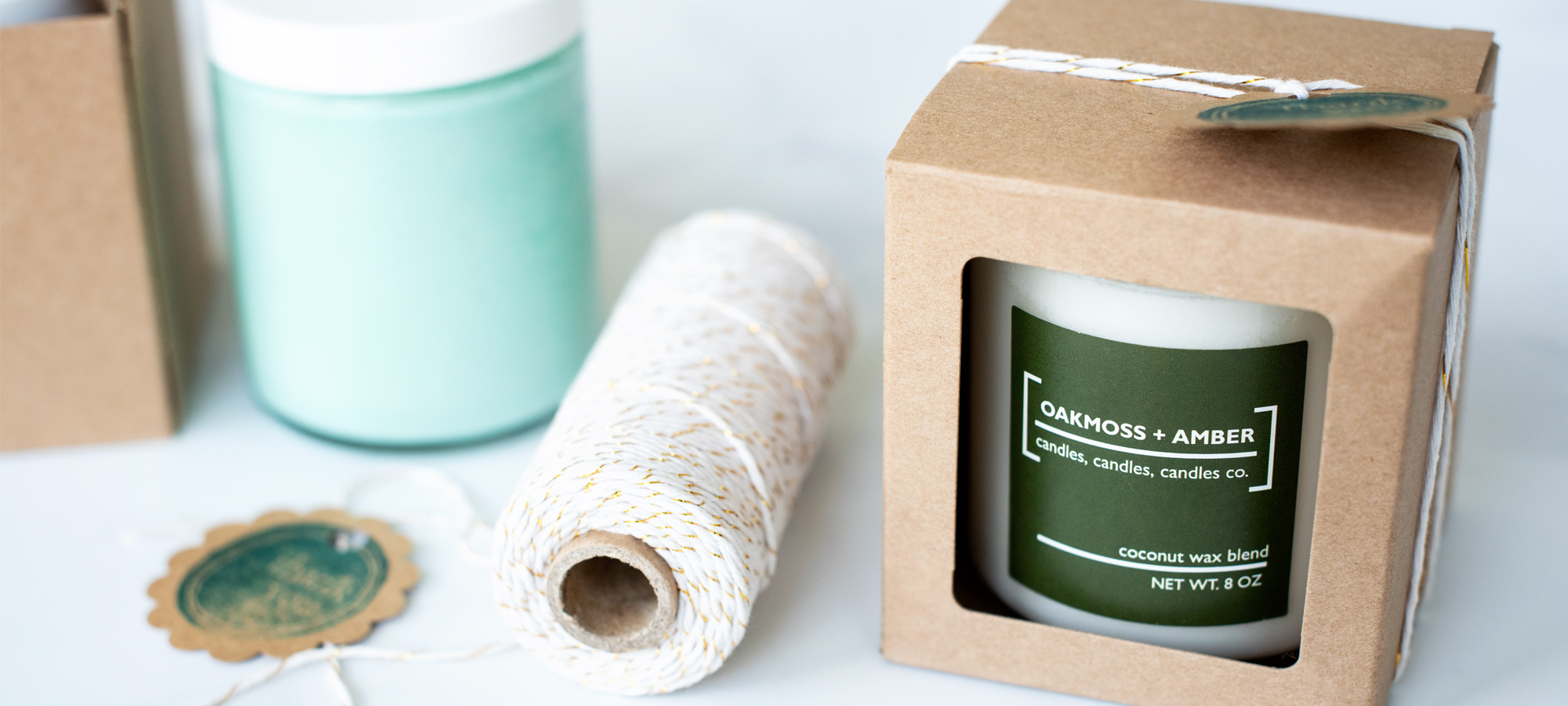 A packaged candle with baker's twine ready to sell on Etsy.