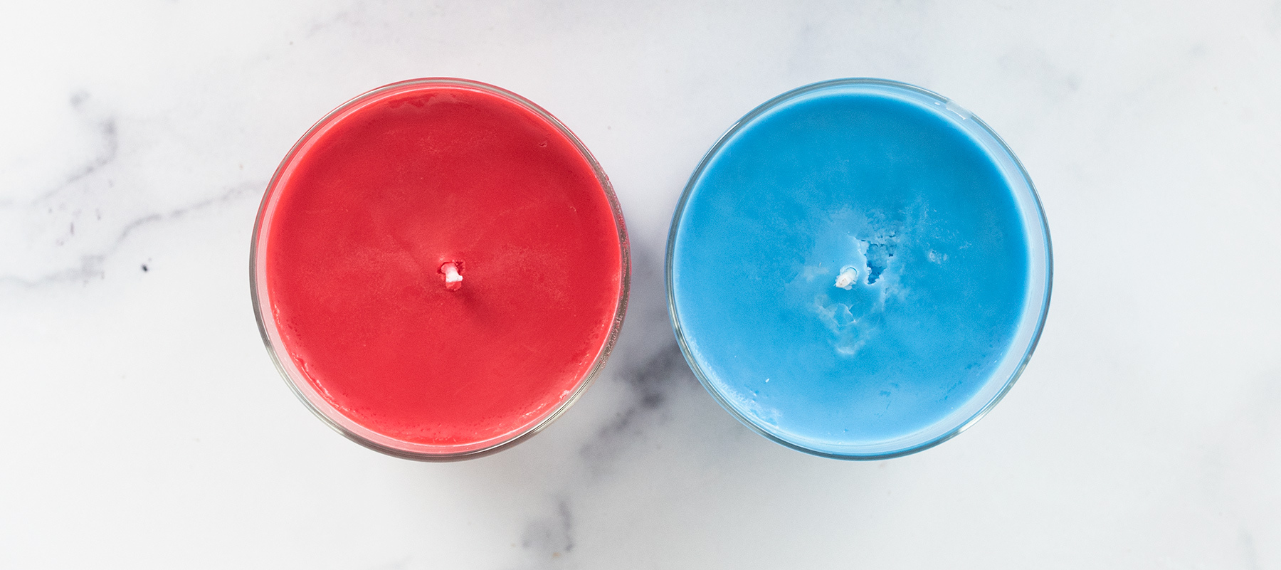 Overhead of colored container candles.